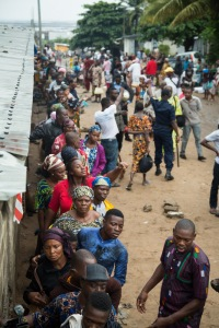 Potential patients wait in line at the Screening Center in Cotonou